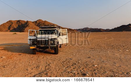 Namibia, South Africa, August 18: Land Rover in stone desert, August 18, 2015 in Namibia, Etosha-national park