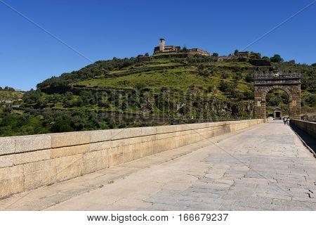Roman bridge over the Tajo river in Alcantara Caceres province Extremadura Spain (In the top view of the town of Alcantara)