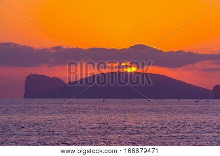 a pink sunset in Capo Caccia Sardinia