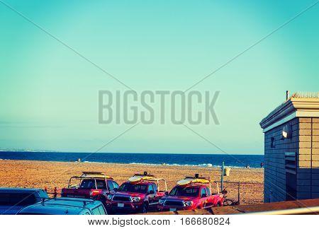 three lifeguard trucks in Newport Beach California