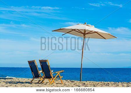 parasol and beach chairs in Malibu California