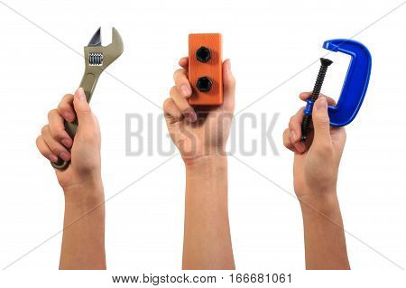 Engineer Tool Toy Concept. Boy Hand Holding Pipe Wrench, Screw Bolt Nut And Carpenter C-clamp Toy To