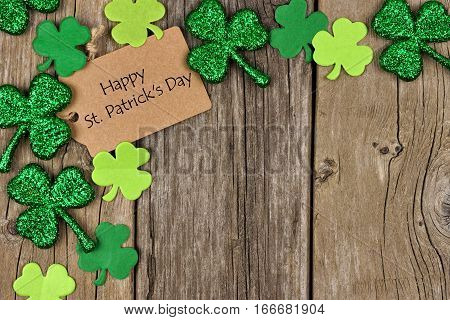 Happy St Patricks Day Tag With Corner Border Of Shiny Shamrocks Over A Rustic Wood Background