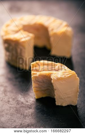 Portion Cut From Whole Camembert Cheese With Golden Color