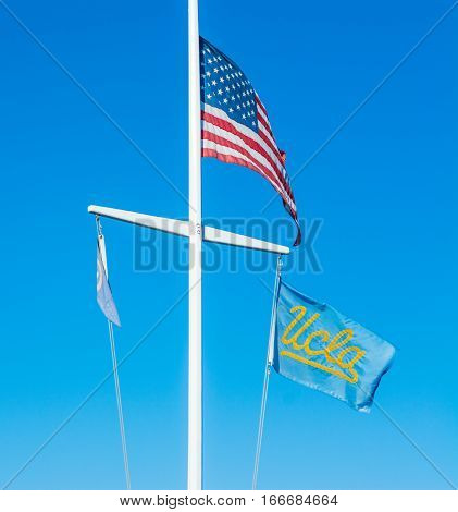 Los Angeles California - November 02 2016: US and UCLA flags under a clear sky