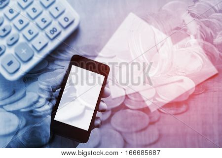 Online banking and mobile banking concept, Double exposure stack of coins with hand holding smartphone mobile and account bank for online finance
