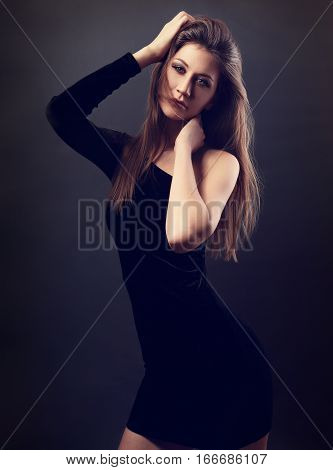 Sexy Slim Model With Perfect Figure Posing In Black Dress On Dark Grey Background And Looking Sexy W