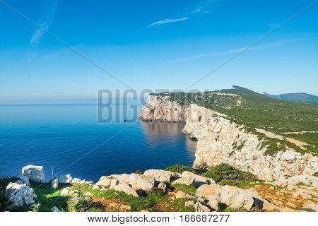 small clouds over Capo Caccia in Sardinia