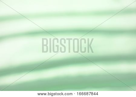 green blurred background with dark and bright stripes