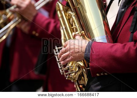 Plays The Saxophone