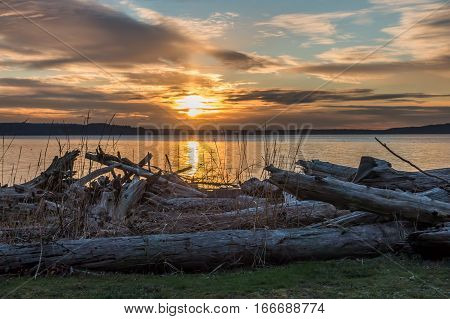 The sun sets over the Puget Sound in the Pacific Northwest.