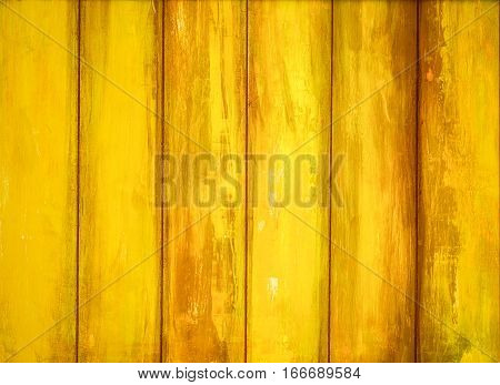 Yellow old peeling paint wooden background texture