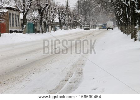 The slippery urban road after a snowfall