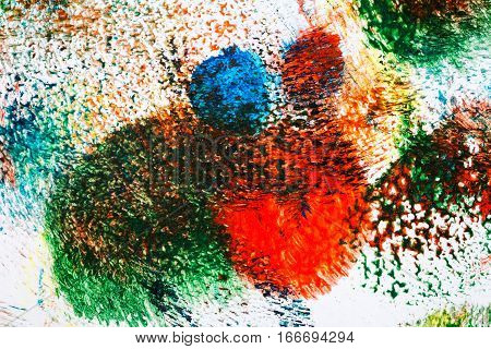 Macro shot of abstract vibrant acrylic art background. Multicolor light and bright texture. Fragment of artwork. Spots of acrylic paint. Modern contemporary art.