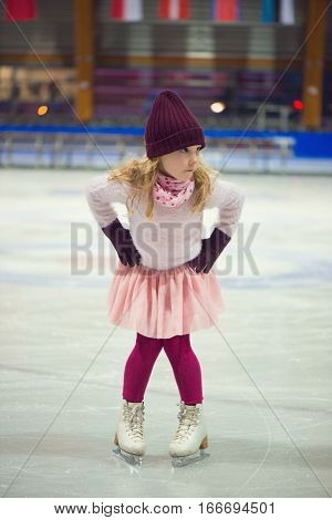 Pretty Girl Skates In A Red Cap, Warm Gloves And Sweater