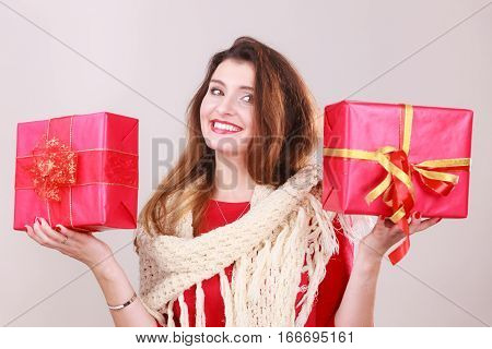 Woman holding two gifts. Young cheerful girl with ribbon boxes. Christmas santa holiday celebration relax leisure fashion concept.