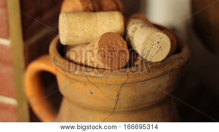 corks from wine bottles in an old jug