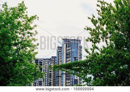 multi-storey residential buildings view from the park.