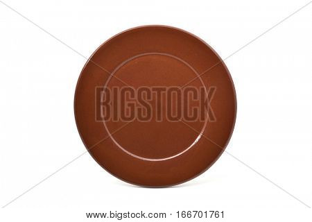 closeup of an empty brown earthenware plate on a white background