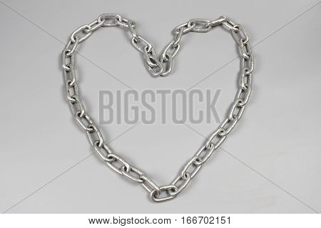 chain on gray background, heart of chain