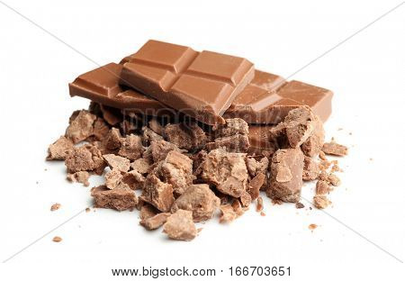 Broken milk chocolate pieces with morsels on white background