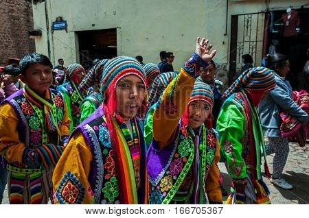Cusco Peru - October 7 2016: Peruvian boys wearing traditional clothes take part in a festive procession.