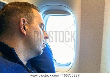 Man sleeping onboard during the long flight