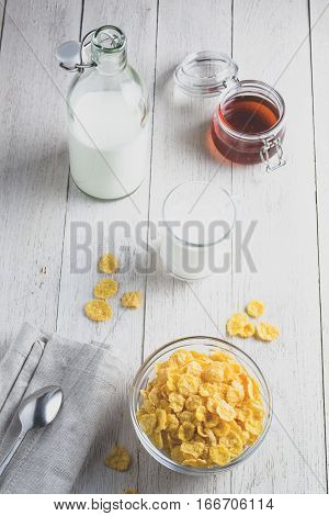 Cornflakes And Milk On A Light Wooden Background