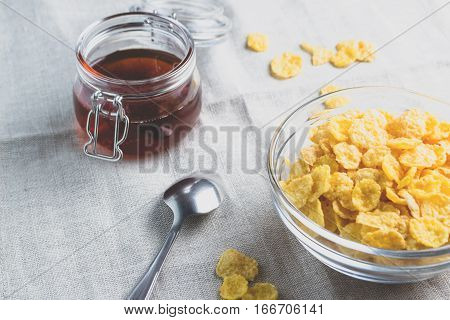 Cornflakes And Honey On A Light Background