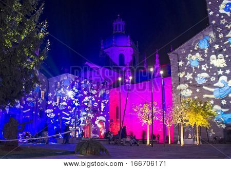 COMO, ITALY - DECEMBER 2, 2016: Christmas light show on facades of buildings on Piazza Duomo (Cathedral Square) in Como old town