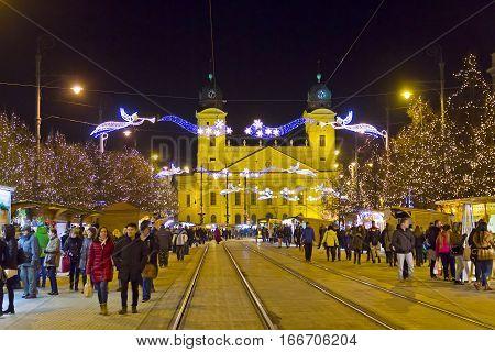 DEBRECEN, HUNGARY - DECEMBER 13, 2016: People walking at traditional Christmas Market on Kossuth square (Kossuth ter) in center of Debrecen old town