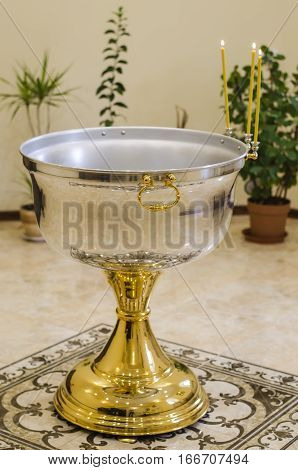 jug of water in the church for the baptism of infants