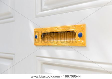 Colorful Letter Box on a White Door