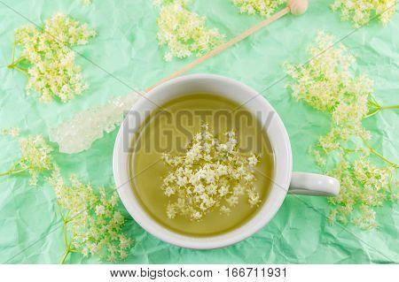 Elderflower Tea In White Cup And Elder Flowers