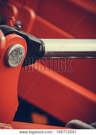 Agriculture equipment concept. Industrial detaild pneumatic hydraulic red machinery made of steel.
