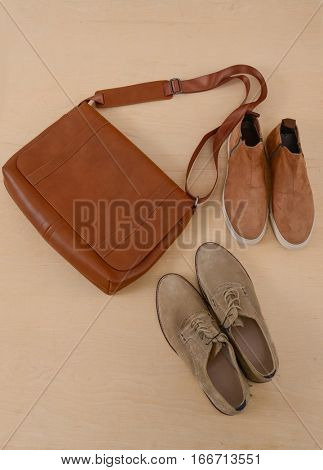 Men's casual outfits with boots shoes and handbag on wooden background