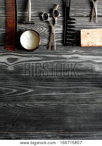Tools for cutting beard barbershop top view on dark wooden background