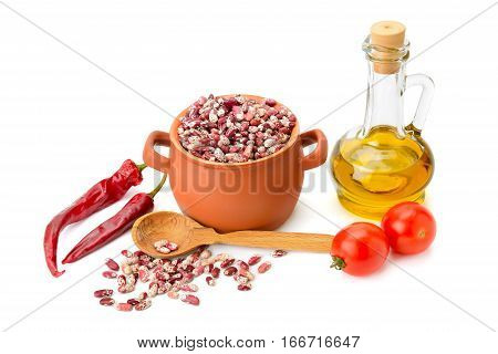 beans in a ceramic pot cooking oil and vegetables isolated on white background