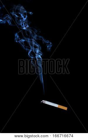 smokes a cigarette on a black background is harmful to health