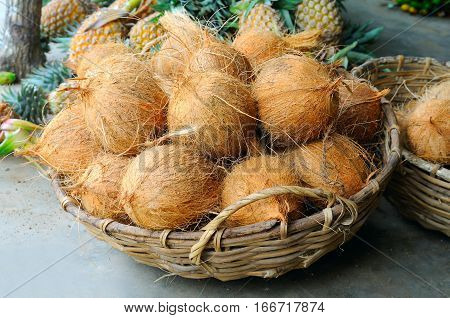 Coconuts in the basket in a vegetable shop