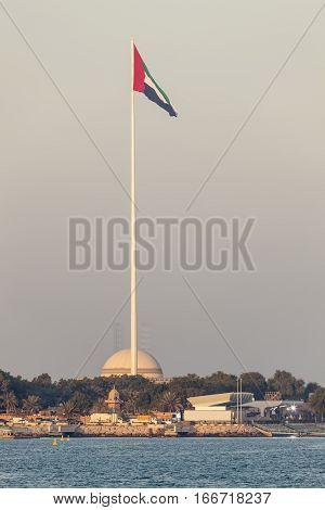 Giant flagpole with the UAE natinal flag in Abu Dhabi United Arab Emirates