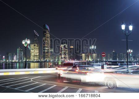 Traffic on the corniche of Abu Dhabi at night. United Arab Emirates Middle East