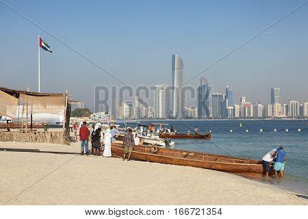 ABU DHABI UAE - DEC 3 2016: Traditional arabian wooden boats on the beach in Abu Dhabi United Arab Emirates