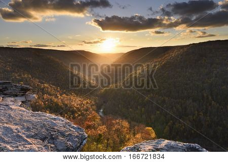 View of Valley in Autumn from Rocky Cliff