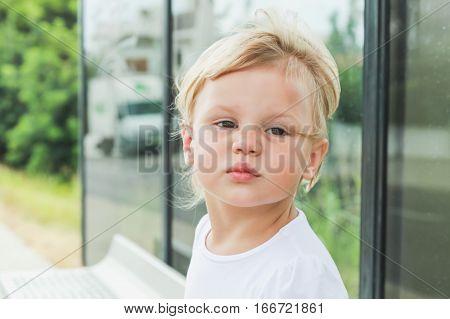 Closeup Portrait. Cute Blond Baby Girl