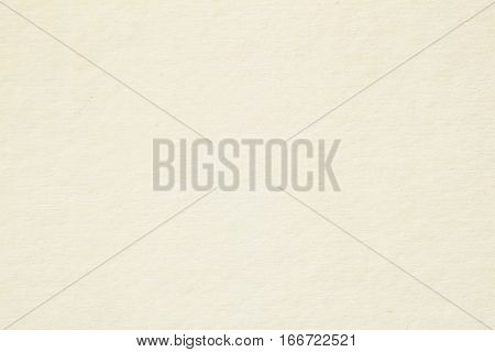 Texture of light cream paper for artwork. Background for design with copy space