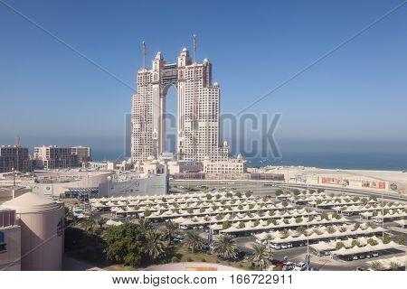 ABU DHABI UAE - DEC 3 2016: View of the Fairmont Marina Residences building and the Marina Mall in Abu Dhabi United Arab Emirates