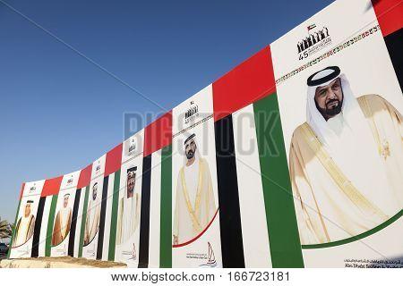 ABU DHABI UAE - DEC 3 2016: Billboard with portraits of the UAE rulers and sheikhs in the city of Abu Dhabi United Arab Emirates