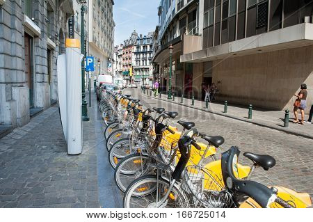 BRUXELLES BELGIUM - AUGUST 13 2012: Line of yellow new public bycicles transportation system for environment in the urban street