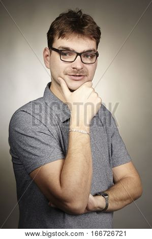 Adult man in glasses posing in studio